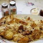Запечённые картофельные дольки с тёртым ссыром